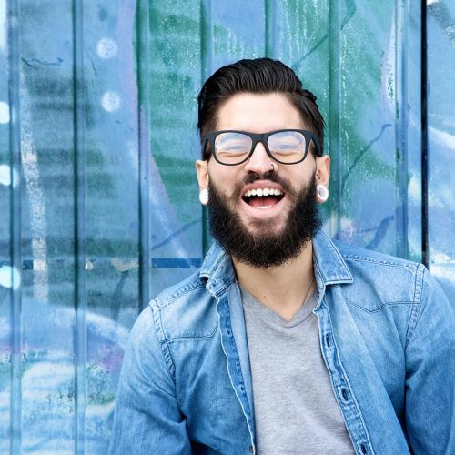 young-man-with-beard-laughing-PF3S7ZY.min_.jpg